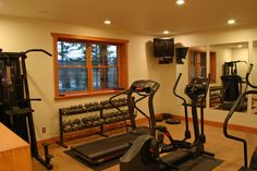 Interior Designs,Alluring Home Workout Room Ideas With Stylish Corner Tv Wall Unit And Nice Windows Plus Cool Mirror Wall Also Contemporary Brown Wood Flooring,Modern Home Workout Room Ideas