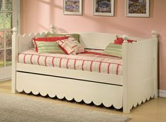 super cute scalloped daybed. and it has a trundle!