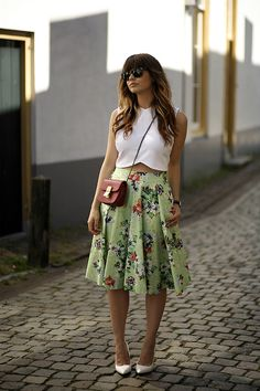 Shop this look on Lookastic: http://lookastic.com/women/looks/cropped-top-and-crossbody-bag-and-midi-skirt-and-pumps-and-sunglasses/3093 — White Cropped Top — Red Leather Crossbody Bag — Green Floral Midi Skirt — White Leather Pumps — Black Sunglasses