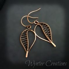 Striking! The Winter Leaf earrings are created entirely from copper wire, hammered and woven up one side in a delicate pattern. These earrings measure 4 cm (about 1.5 inches) long, and 2 cm (about 3/4 of an inch) across at the widest point. Solid copper ear wires.