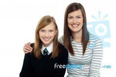 """""""Mom Posing With Arms Around Her Cute Daughter"""" by stockimages at FreeDigitalPhotos.net"""