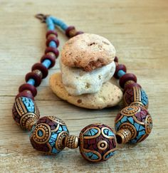 Large beaded polymer clay necklace in Tibetan style is one of my series of ethnic jewelry.  Faux metal, turquoise and coral repeat the