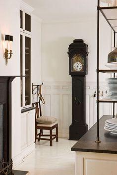 Designer Darryl Carter | a corner of his magnificent black and white kitchen #todiefor #whiteonwhite