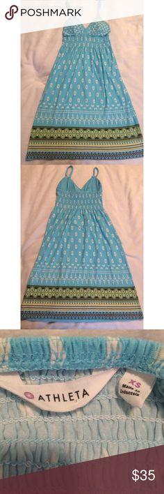 """Athleta Triangle Top Light Blue Printed Sun Dress Great Condition with normal wear throughout. Some light pilling near the bust and straps. Perfect for the beach or pool as a swimsuit cover up. Soft and very comfortable. Smocking at the waist. Lightly padded with removable pads. Measurements are: 36"""" long from top of the shoulder to bottom hem, 11.5"""" under the bust, fits a-b, waist 17"""" with stretch. Straps are adjustable. Athleta Dresses"""