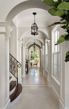 white hallway with lots of arches and windows, iron stair case......I can dream!!!