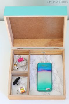 Cell Phone Charging Station that HIDEs your cords. A must for any home office or bedroom space. Make things look less messy with this DIY idea.