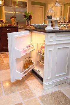 Drink fridge under kitchen island. Saves room in the big fridge and easily accessible while looking good.
