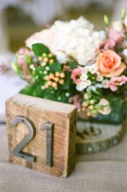 Rustic wood table numbers with brushed steel numbers.