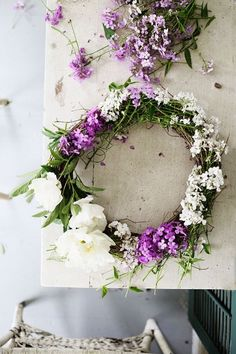 Beautiful flower crown adorn with white and violet flowers.