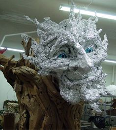 Seattle sculptress Kim Graham and her team made this amazing troll sculpture out of reclaimed lumber, discarded cardboard, and papier mach. Paper Mache Clay, Paper Mache Sculpture, Sculpture Art, Sculptures, Diy Garden Decor, Garden Art, Troll, Graham, Hallowen Ideas