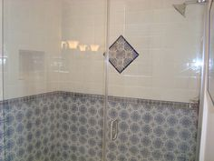 Hand painted Spanish bath tile create a striking accent for the shower wainscot. Wainscoting Bathroom, Bath Tiles, Spanish Tile, Mediterranean Homes, Bathroom Furniture, Bathtub, Home And Garden, Shower, Wall