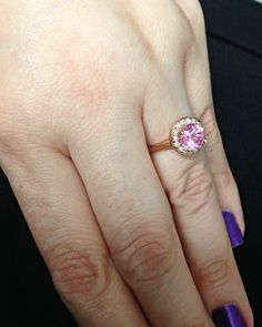 pink sapphire in a halo set in 14k rose gold