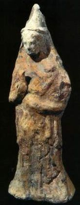 Terracotta figurine fusing Greek style with Iberian dress. The mold-made head was attached to a handmade torso.  Tossal de Manises, Alicante.