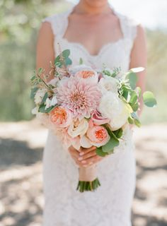 Dahlia and garden rose bouquet: http://www.stylemepretty.com/2015/07/03/elegant-4th-of-july-vineyard-wedding/ | Photography: Caroline Tran - http://carolinetran.net/