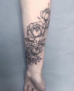 Peonies on forearm by Anna Bravo More