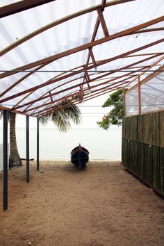 Built in three weeks, the 56-square-metre pavilion comprises a wooden structure, blockwork walls and cladding made from locally sourced bamboo. Beachfront Property, Modular Structure, British Seaside, Forest Park, Seaside Towns, Green Backgrounds, Cladding, Brazil, Pergola