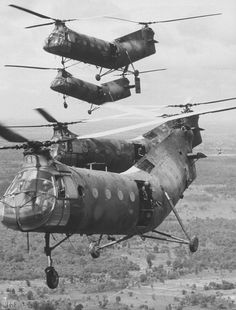 CH-21C Shawnees over Vietnam  US crews & gunners, transport ARVN troops to battle areas near Cambodian border.Removed vertical stabilizers suggests 8th Trans units  Photo by Larry Burrows for LIFE, 1964