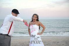 Trash the dress ceremony after beach wedding on Assateague Island:  https://www.roxbeachweddings.com/