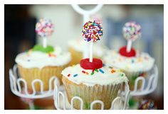 cute idea... for cupcakes. it's a dum dum sucker dipped in water and then sprinkles. cute.