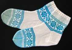 Ravelry: ringofkerry's Special Request variation of Fair Isle Flower Sock pattern by Candice DeWitt.  Free, dl'd.  The toe stripes add to it.
