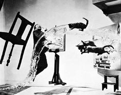 Dalí Atomicus, a surrealistic photograph of Dalí in his studio, was taken by Philippe Halsman, one of the most recognizable artist portraits ever!