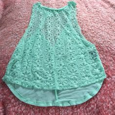 Turquoise tank top Turquoise tank top, flowers details,. NWOT. Fits xm-small Tops Tank Tops