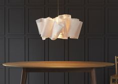 Pinch design...this fixture is softer and more subtle than the similar one in glass.