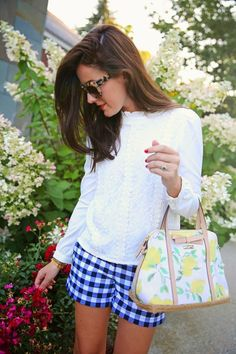 Love the cool white top and cute shorts