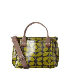 Orla Kiely: Shiny laminate handbag with large pockets to front and back. Webbing tape handles reinforced with stamped birch leather. Inside details include zip pocket and key chain. Zip closure. Detachable adjustable strap that allows the bag to worn as a shoulder bag or across the body (max 40in). This bag is unlined.