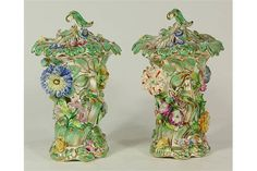 Lot 2008 - Pair of English porcelain flower-encrusted lidded vases, circa 1830, possibly Minton or