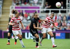 New Zealand's Amber Hearn, center, vies for the ball with United States' Lauren Cheney, left, and Carli Lloyd, right, during their women's quarter-final soccer match at St. James' Park in Newcastle, England, during the London 2012 Summer Olympics, Friday, Aug. 3, 2012. Photo: Scott Heppell / AP