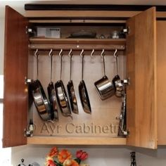 Hanging Pots and Pans - Get Organzed in 2013 - Kitchen and Home Organization Tips and Ideas (found on Pinterest)