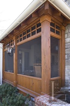 Partial kneewall screen porch railing with heavy columns and decorative trim.