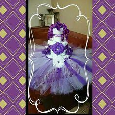 Tutu diaper cake with purple socks, & purple flower crochet headband 69 size 1 diaper. If any questions please call me 7869165336