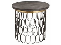 Round side table supported by an iron base made from an interlocking scallop pattern and topped with rough hewn black marble accented with a ribbon of gold leaf banding.