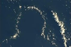 Cmdr_Hadfield: Just south of the Galapagos, this cloud is waiting for you to draw a face. Chris Hadfield, Galapagos Islands, Earth From Space, Planet Earth, Ocean, Clouds, Drawings, Water, Waiting