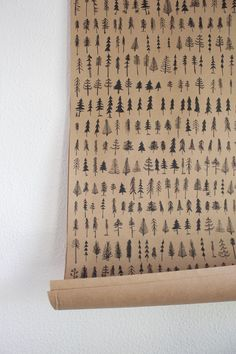 Forest or trees? Hand drawn pine trees printed on kraft wrapping sheets wrap a present in an outdoor spirit. Made in small batches by the husband and wife team behind We Are Brainstorm. Made in New Ha