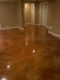"DIY stained concrete floor. Thinking about doing this in the house. (This link is broken, but the website it leads to has an informative ""how to stain concrete"" section that shows acid staining the floor)"