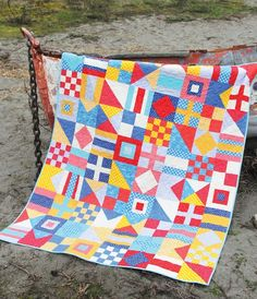 A lovely bright design, based on ships' flags. No instructions, but fairly easy to see how it's put together.