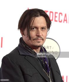 actor-johnny-depp-attends-the-premiere-of-lionsgatess-mortdecai-at-picture-id461932454 (516×612)