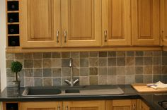 faux painting. I have painted many backsplashes to look like tile and it is an easy and inexpensive solution. First paint the base color tha...