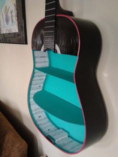 Upcycled Guitar Shelf Aqua Black. $149.00, via Etsy. Would look nice in a music studio.