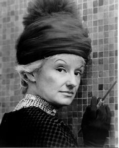 "Phyllis Diller (July 17, 1917 – August 20, 2012) was an American actress and comedienne. She created a stage persona of a wild-haired, eccentrically dressed housewife who made self-deprecating jokes about her age and appearance, her terrible cooking, and a husband named ""Fang"", while pretending to smoke from a long cigarette holder. Diller's signature was her unusual laugh."