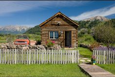 What could be more perfect:  Tiny log cabin, picket fence, old rusty truck, and mountains!  A secret hide-away!
