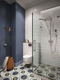 Keep your wall tiles simple and make a statement with gorgeous patterned floor tiles.