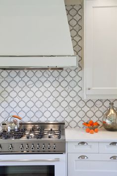 Artistic Tile    Designer Palmer Todd; Photography by Tre Dunham   This beautiful  backsplash features the Toledo Lucido pattern from the Vetromarmi collection.