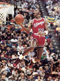 Michael Jordan takes flight at the Slam Dunk Contest, 1985.  Follow us for more exclusive images!
