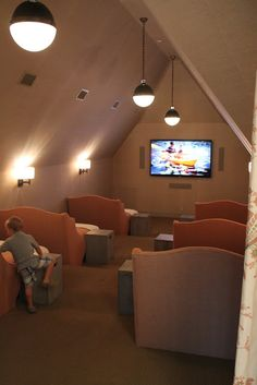 A movie theatre in the attic with large bed/loungers with space for two, located in a beach house. Designed by Erica Powell - Coastal Living Ultimate Beach House. Thanks to The Patriotic Peacock: Miramar and Destin for visiting and sharing their photos.