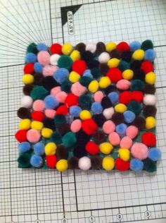 Tiny Pom poms glued to thick cardboard. For sensory experiences. Hand made and designed by Sharon Lee. 16/9/14