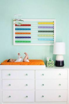 This wall art abacus will look great above your babys crib or just a fun piece of art for the home. Measures at: Height: 24 inches, Length: 37 inches, Width: 1 1/2 inches  Made out of wood  beads are hand painted and glazed  Includes two attached pieces of hardware on back of abacus for hanging needs  You can choose from: * White or Black frame  with  Darker colors (black, green, brown, red, teal, blue, yellow, dark purple, orange, and dark green) or Brighter colors (yellow, red, purple,...